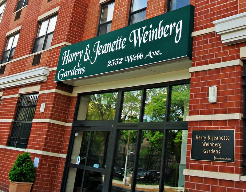 The brick exterior and sun awning of The New Jewish home Harry and Jeanette Weinberg Gardens