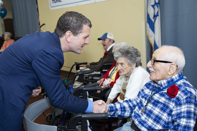 Photo of CEO Jeffrey I Farber and resident centenarians at Kittay House celebration