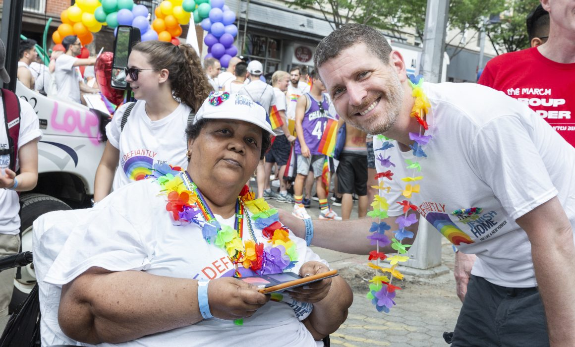 Dr. Jeffrey Farber, President and CEO of The New Jewish Home participates with staff and residents in the NYC Pride March