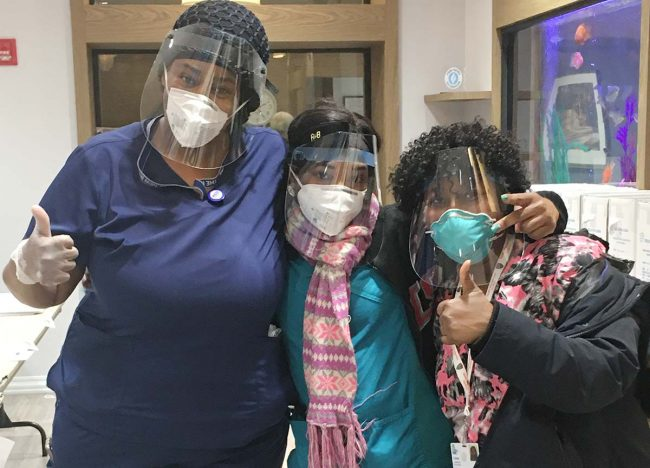 health care workers with protective masks and face shields