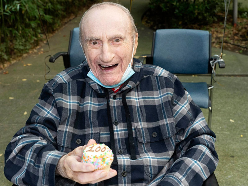 Musician and resident Harold Schachner celebrates his 100th birthday